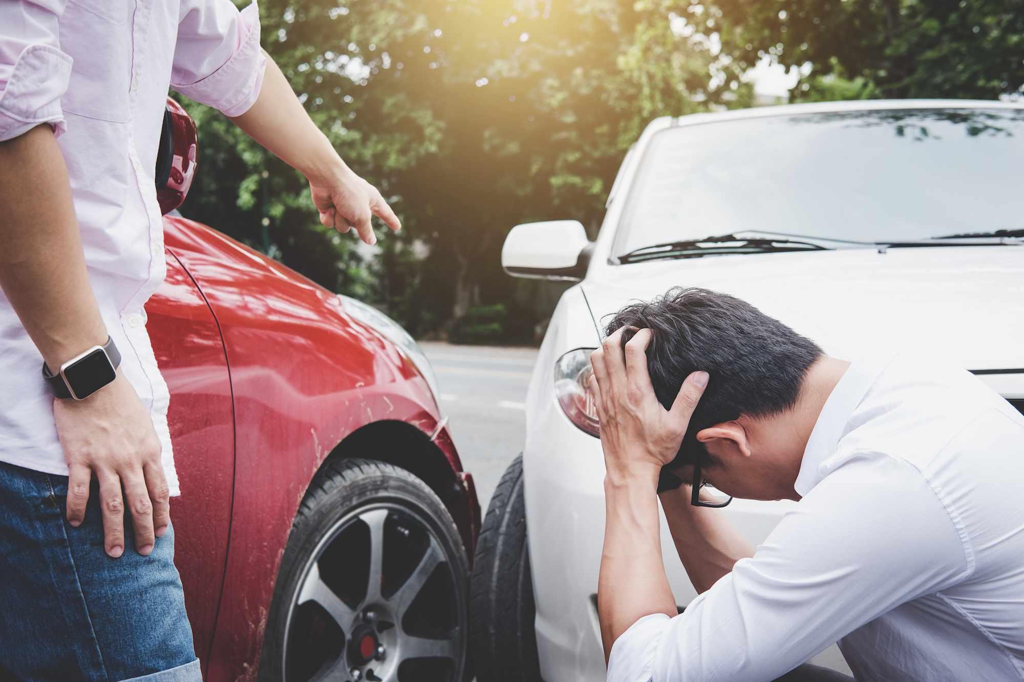 Two men dealing with a car crash
