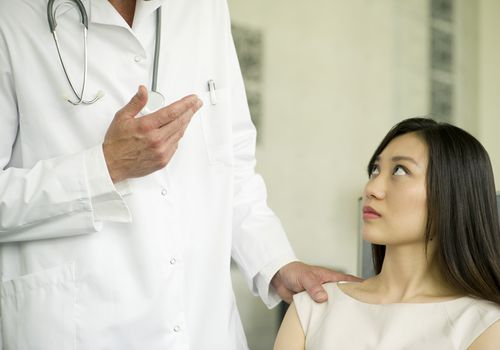 Doctor explaining concept to female patient