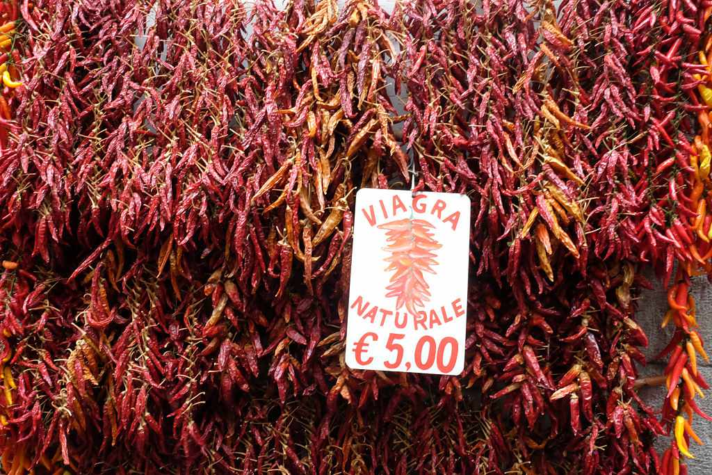 Red chili peppers hanging on the wall