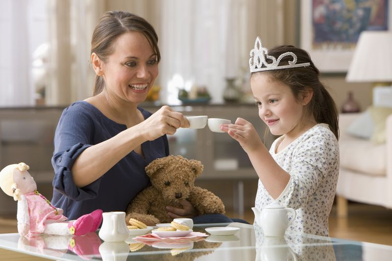 A mother having a tea party with her daughter