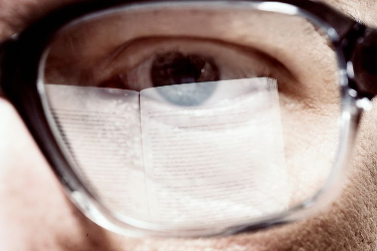 man's eye behind glasses