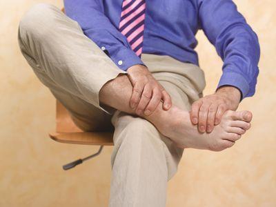 Man holding foot