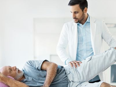 Older gentleman with hip pain having doctor consultation