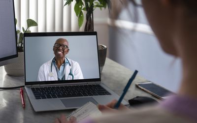 patient talking to doctor on a video call on a laptop