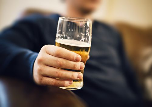 Man holding a beer.