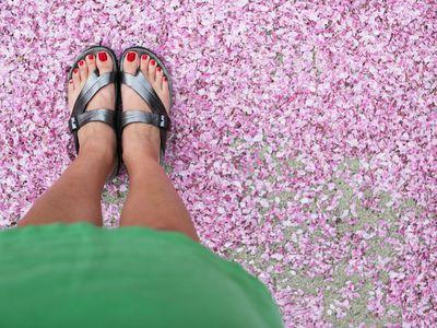 Woman's pretty feet wearing sandals