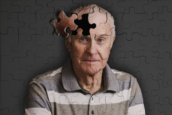 Jigsaw puzzlie, of senior man, falling apart