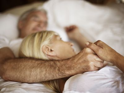 older couple embracing in bed