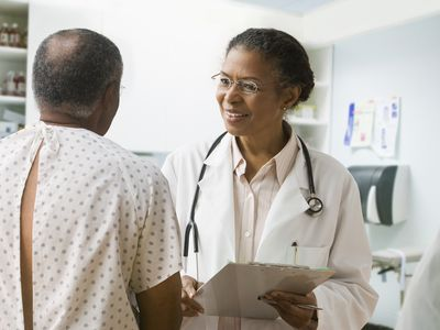 Female doctor speaking to male patient