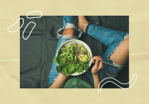 Woman eating a green salad.