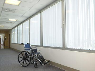Wheelchair in hospital corridor