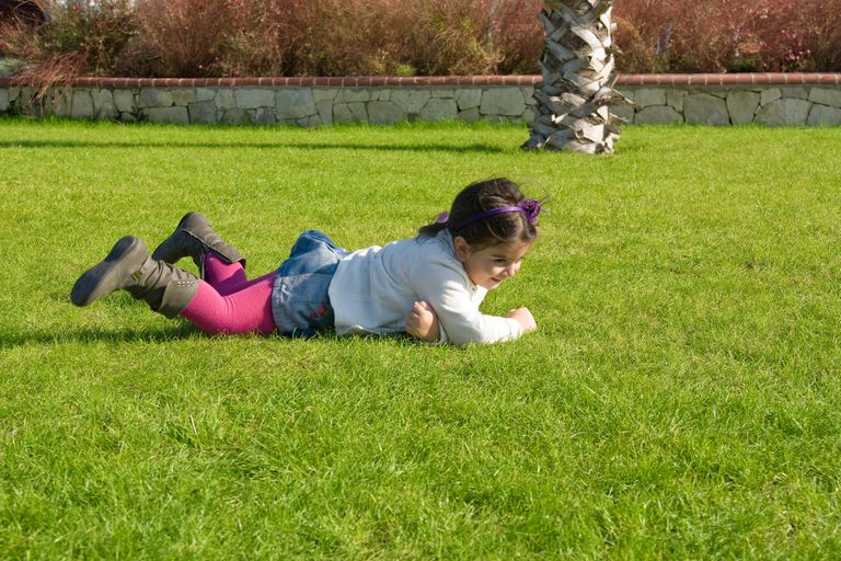 Girl rolling on the grass