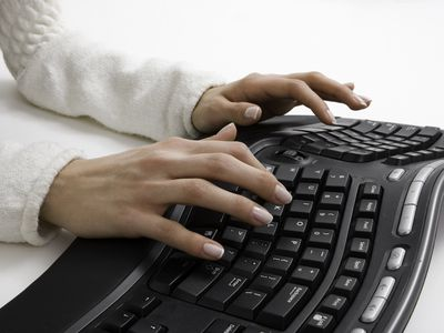 Woman typing on ergonomic keyboard