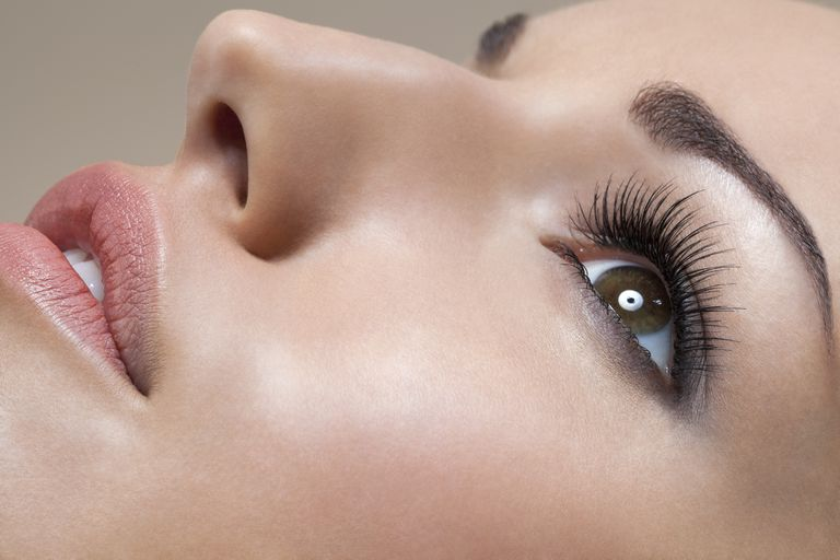 Close up of woman with thick, long eyelashes