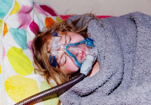 Person wearing sleep apnea equipment