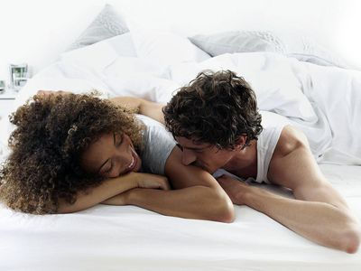 Couple lying on bed together