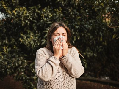 adult woman in the nature suffering allergy