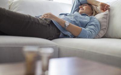 A woman trying to sleep of her headache