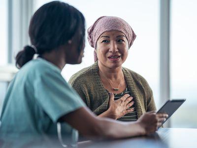 Asian woman diagnosis patient nurse tablet