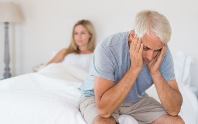 Mature couple upset in bed