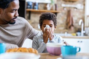 photo of father and son with tissue.