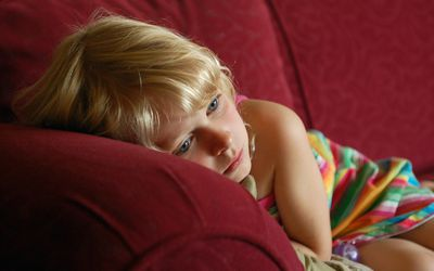 Child laying on sofa