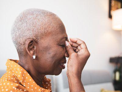 Senior Woman With a Headache