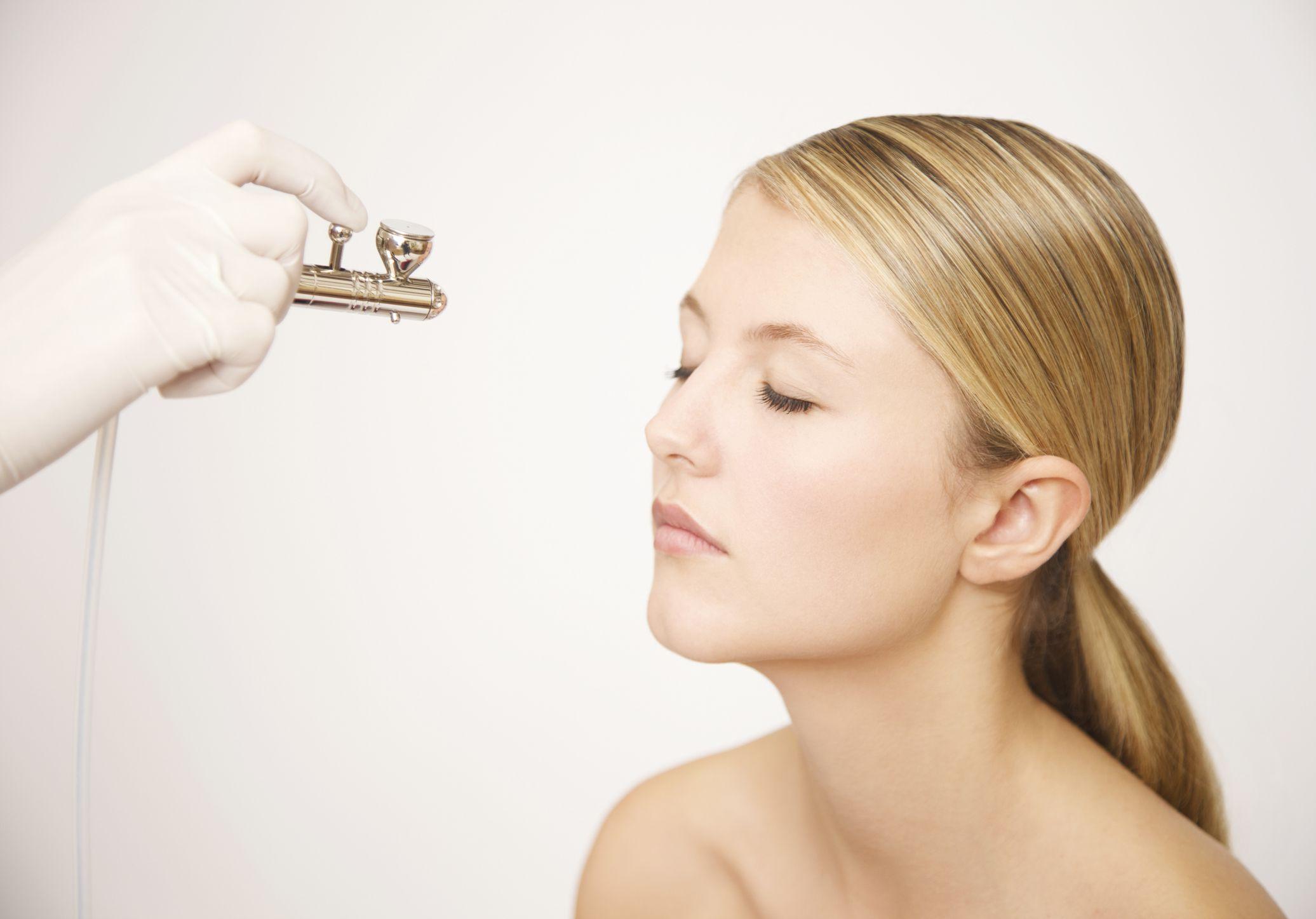 A woman getting a spray tan