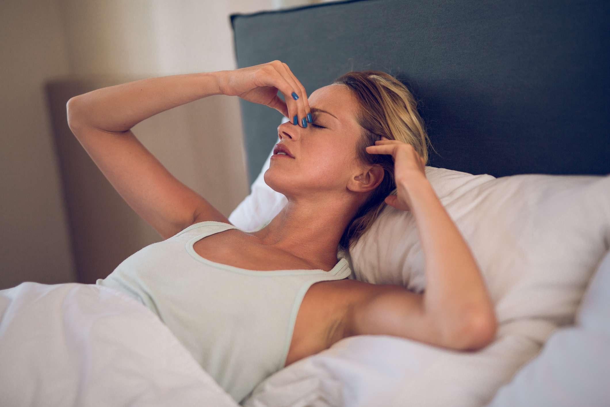Young woman having severe headache