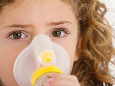 Little girl receiving a breathing treatment.