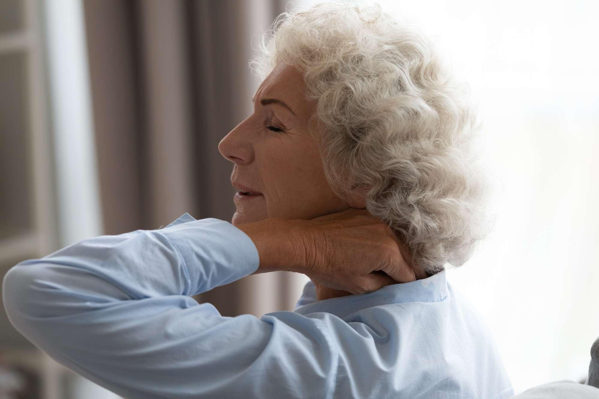 Woman rubbing her neck in discomfort