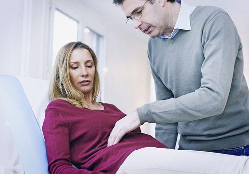 Doctor examining his female patient's pelvis