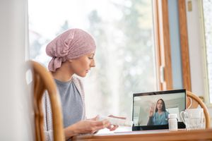 Virtual doctor appointment for cancer patient at home - stock photo