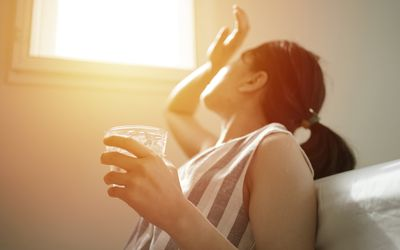 asian female thirsty and dehydration drinking fresh water at summer season at home - stock photo