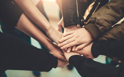 Children's hands together in a circle