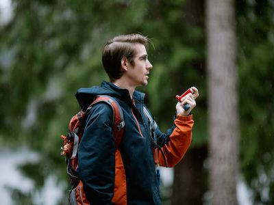 Hiker who has cystic fibrosis uses an inhaler