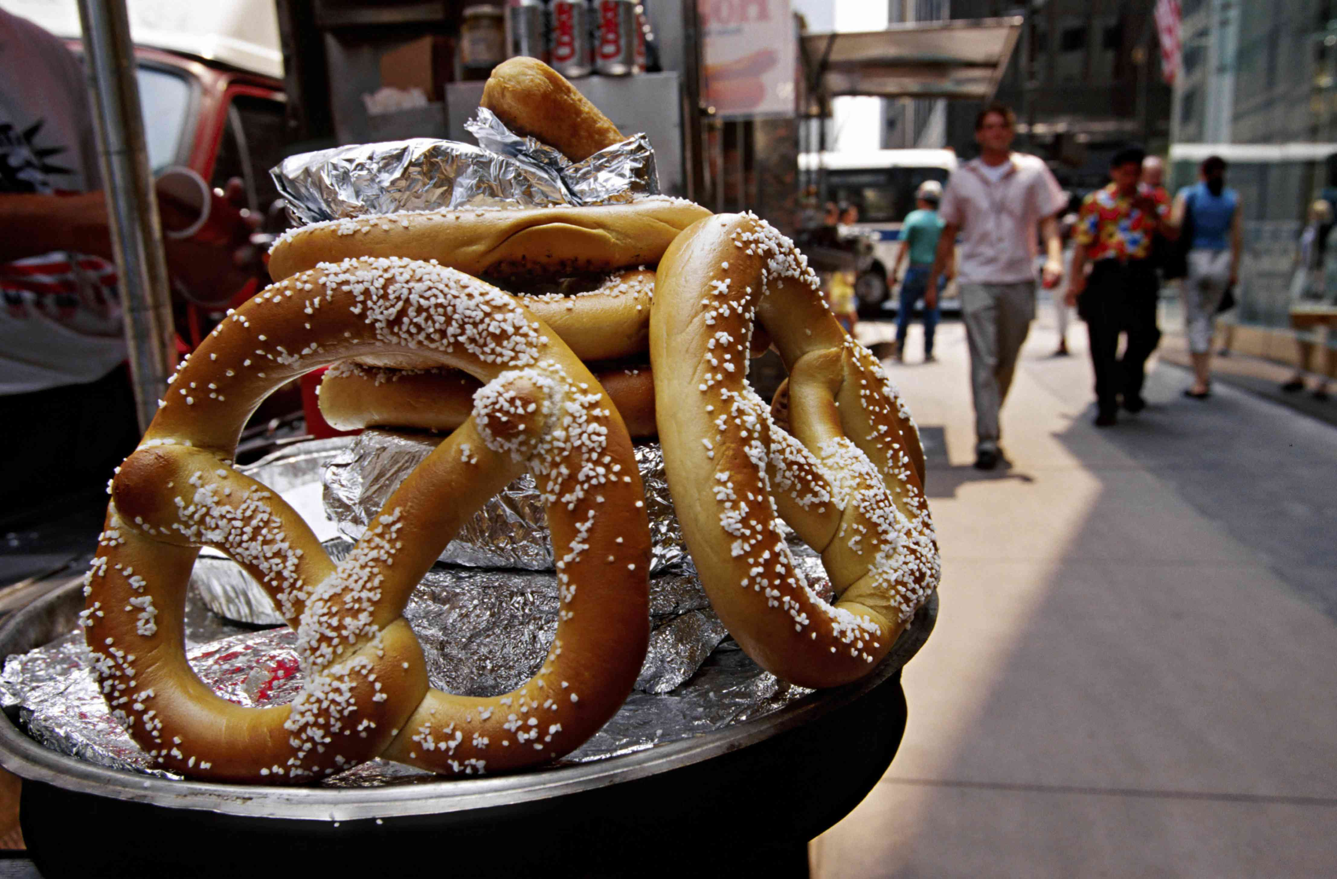 Close up of pretzels being sold on a busy city street