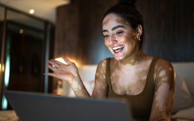 Young woman doing a video call on laptop at home