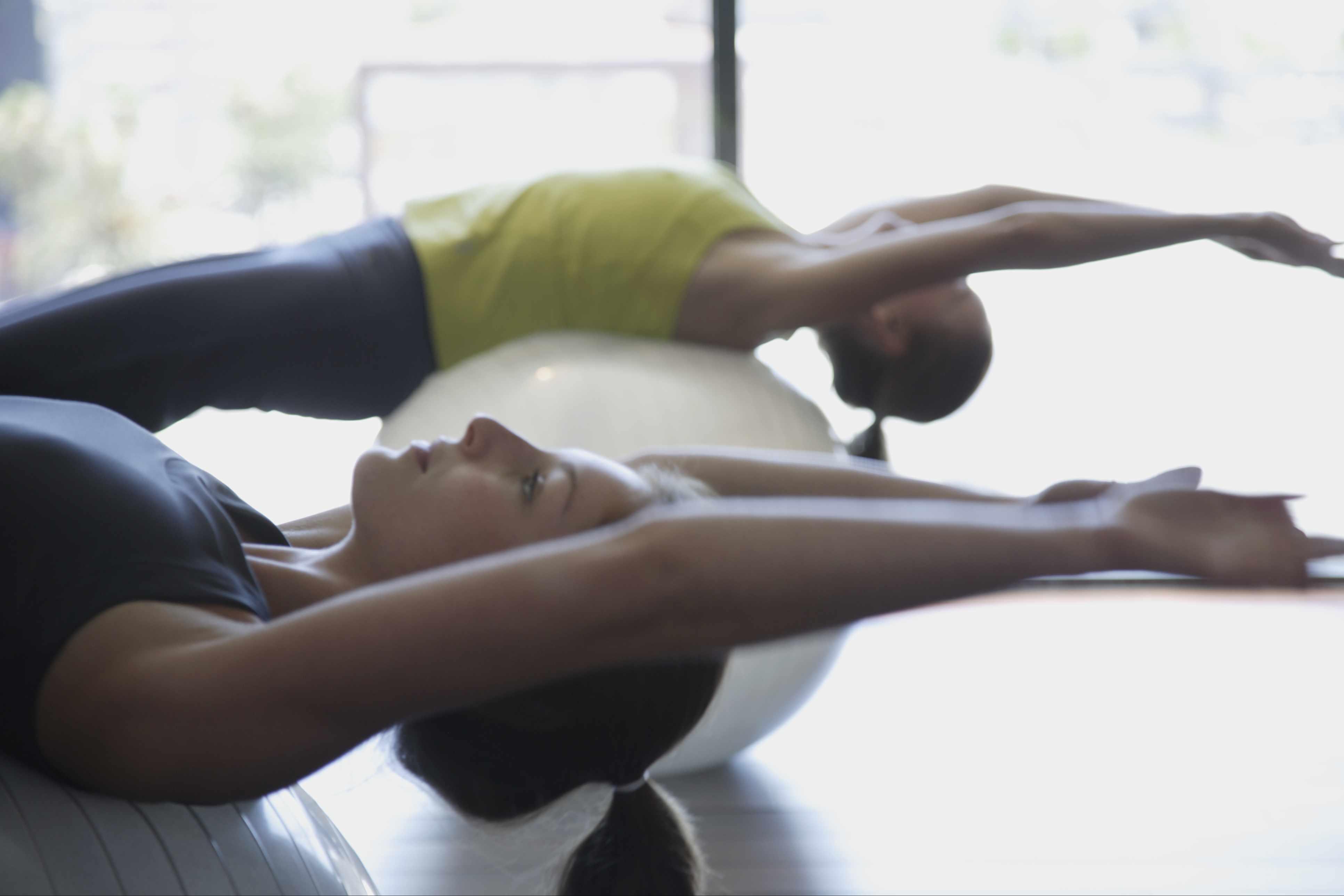 Women using exercise ball