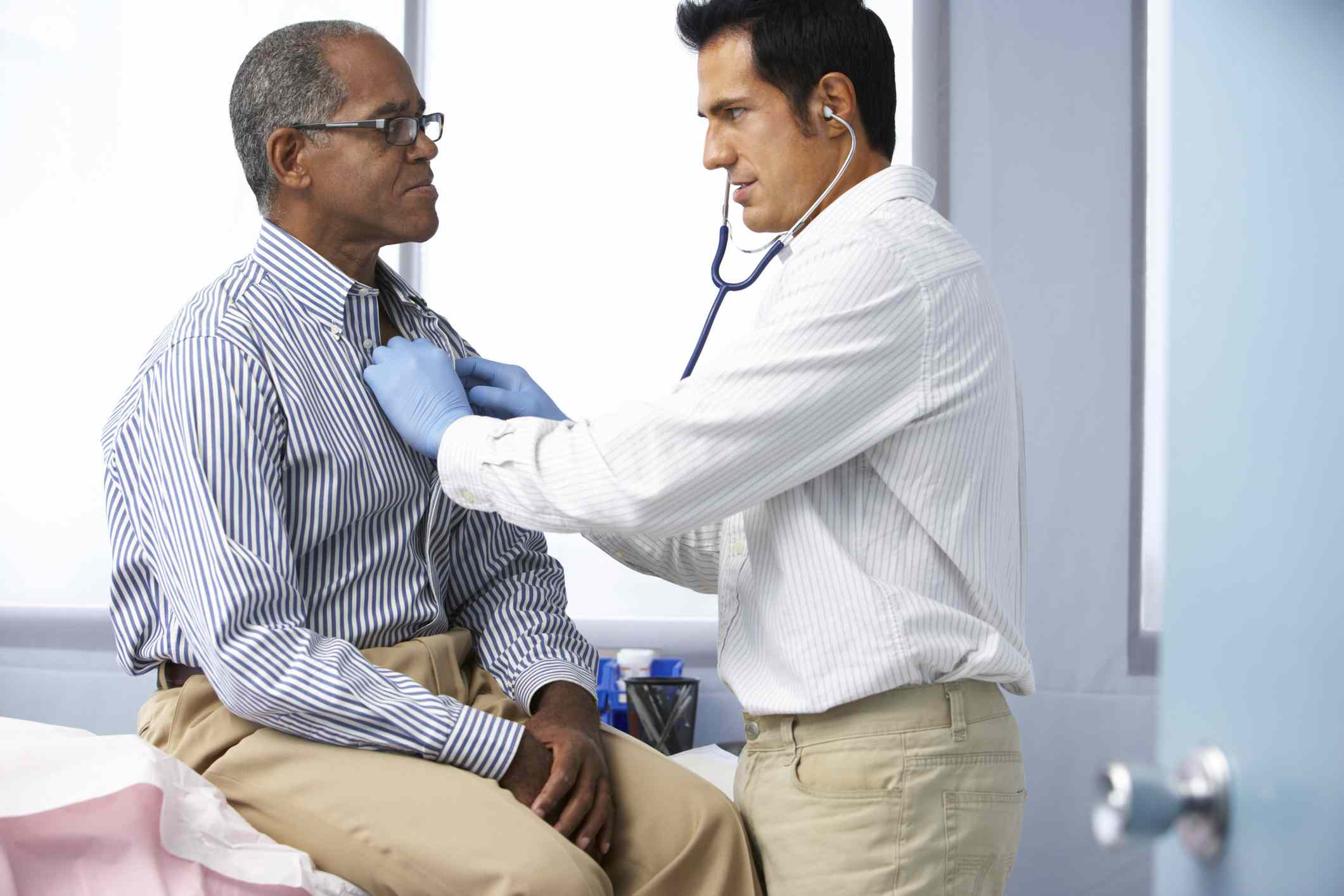Doctor performing heart checkup