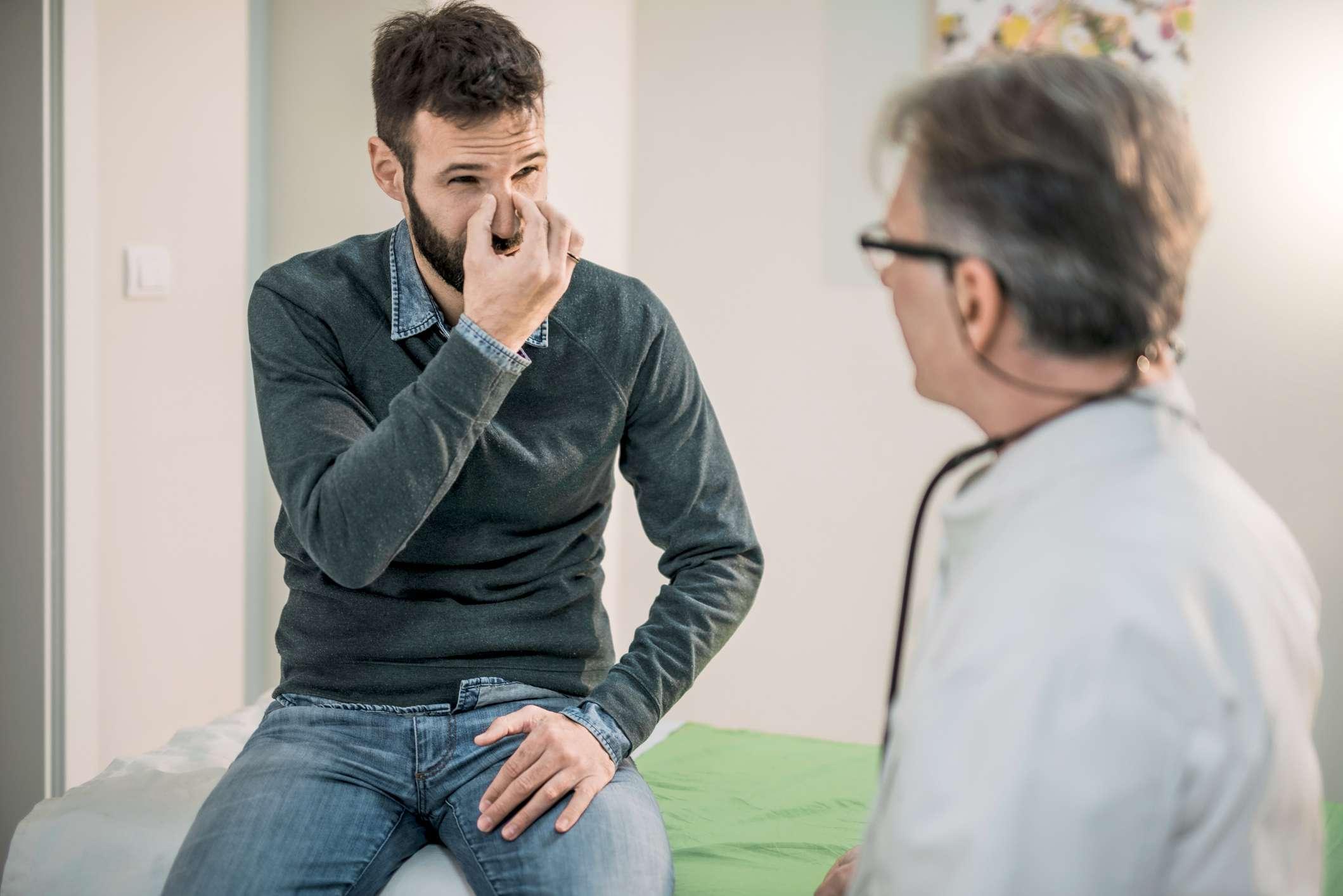 Man describing symptoms