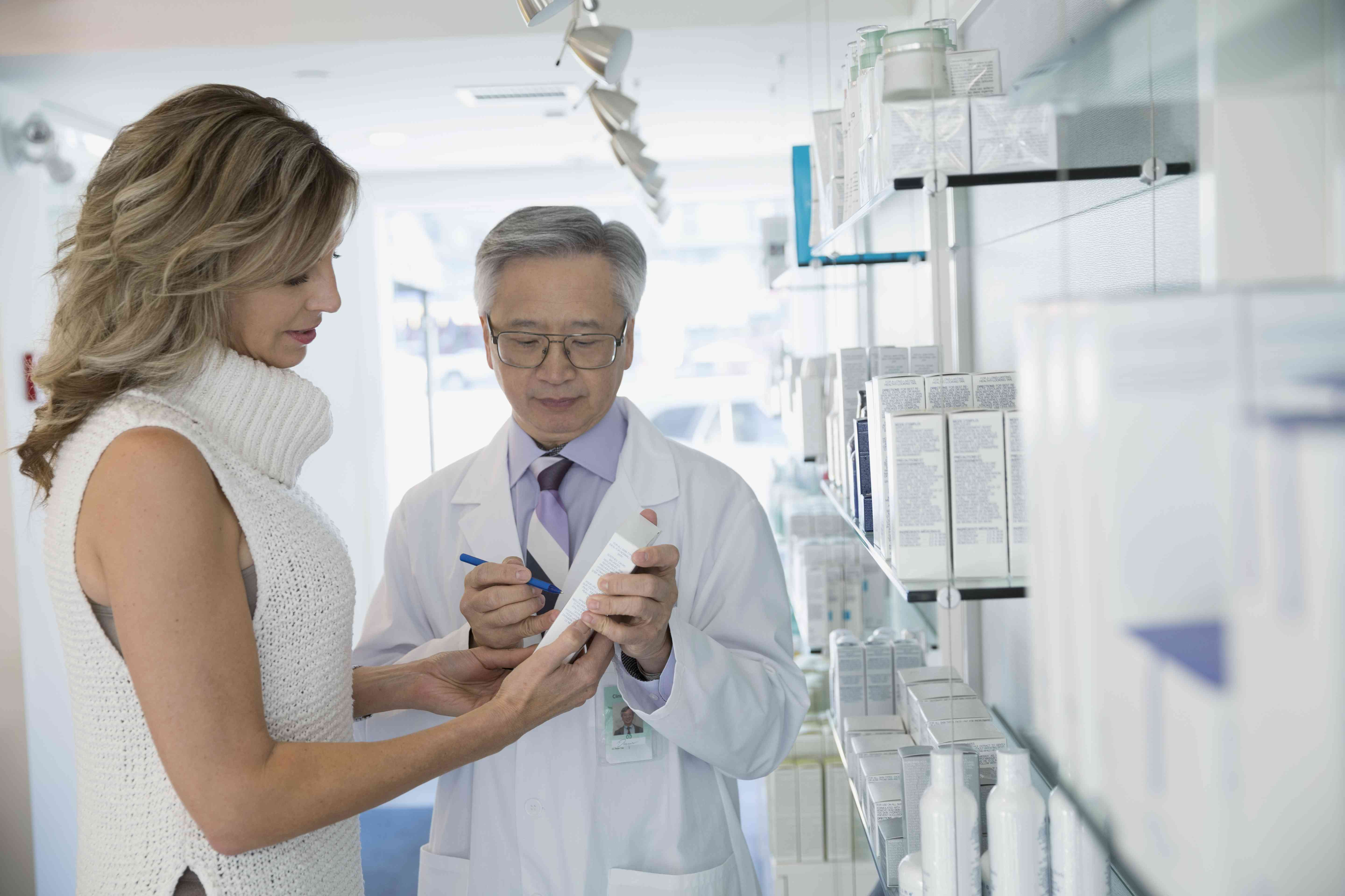 Dermatologist and patient choosing a skin care product