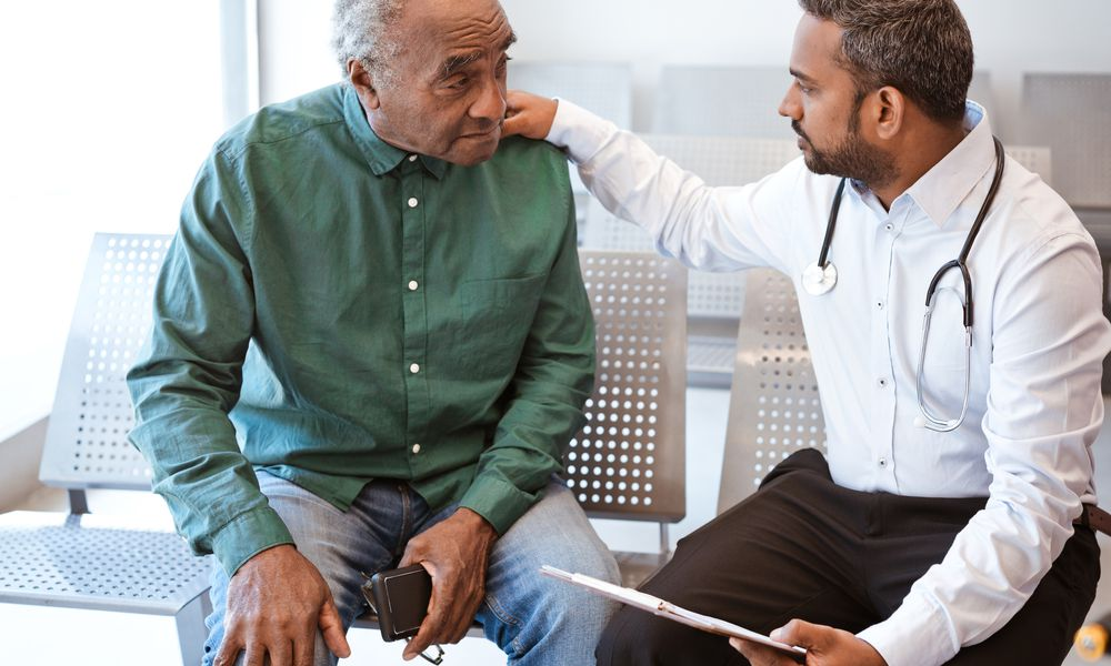 Doctor delivering diagnosis news to a patient