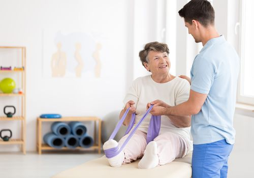 Older woman going through physical therapy
