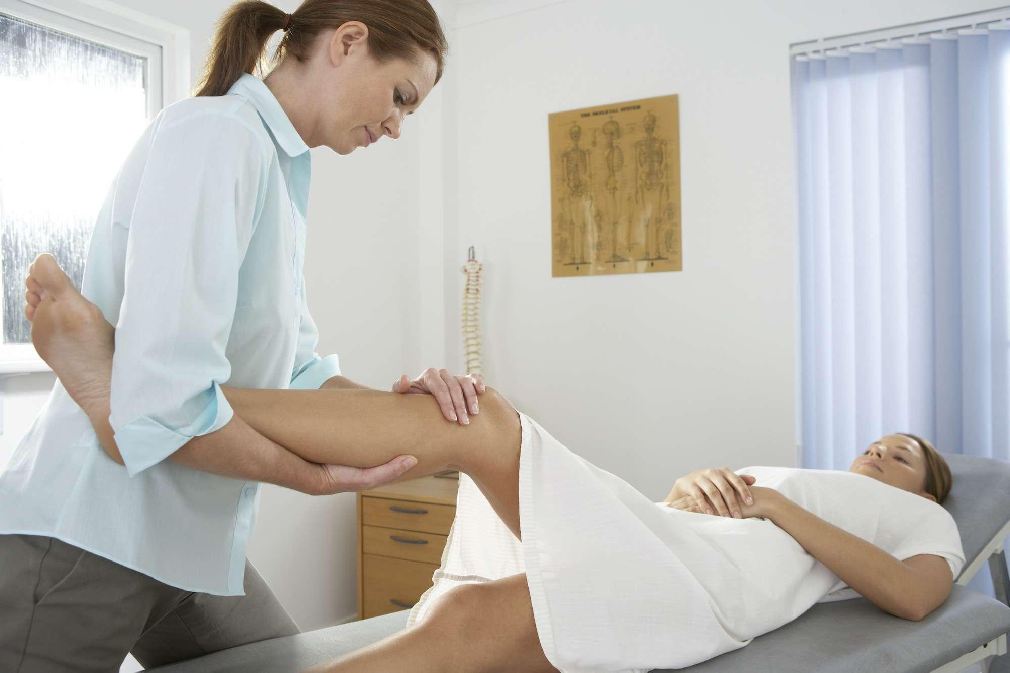 Chiropractic examination of a patient's knee