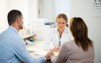 couple having a consultation with a doctor