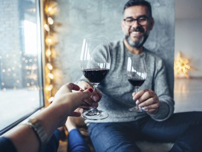 A couple drinking wine wine together