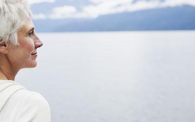 Senior woman looking at view over lake