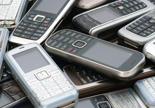 A pile of old cell phones
