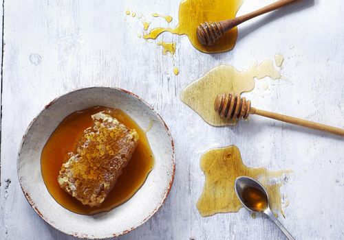 Honey and honey comb in a bowl